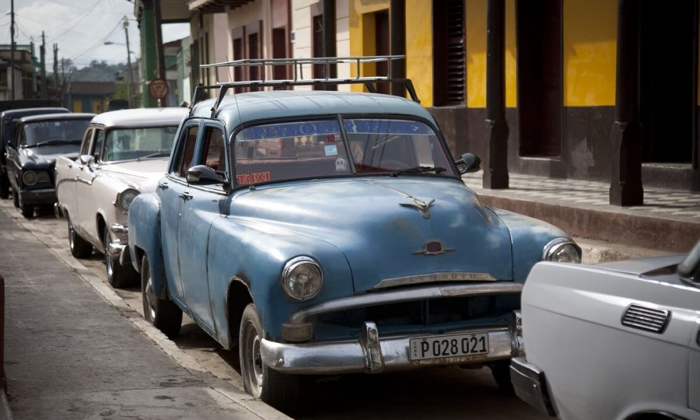 Cuba sites of interest Santiago de Cuba oldtimers on street