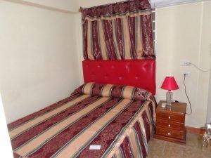 Cuba fotografie rondreis casa particular rode kamer