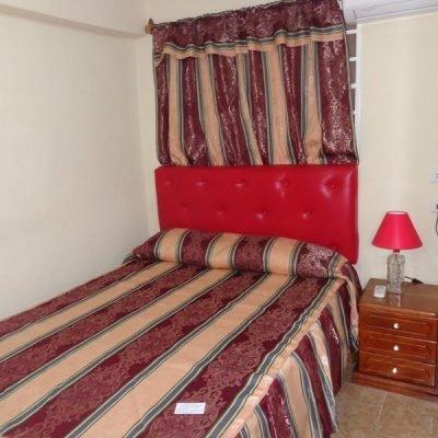 Recorrido de fotografia en Cuba casa particular habitacion roja